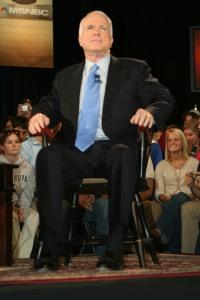 McCain sitting rigidly in his Villanova armchair