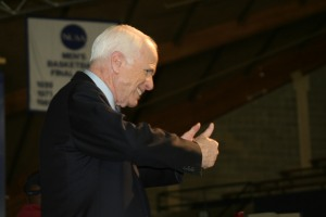 McCain\'s trademark double thumbs up